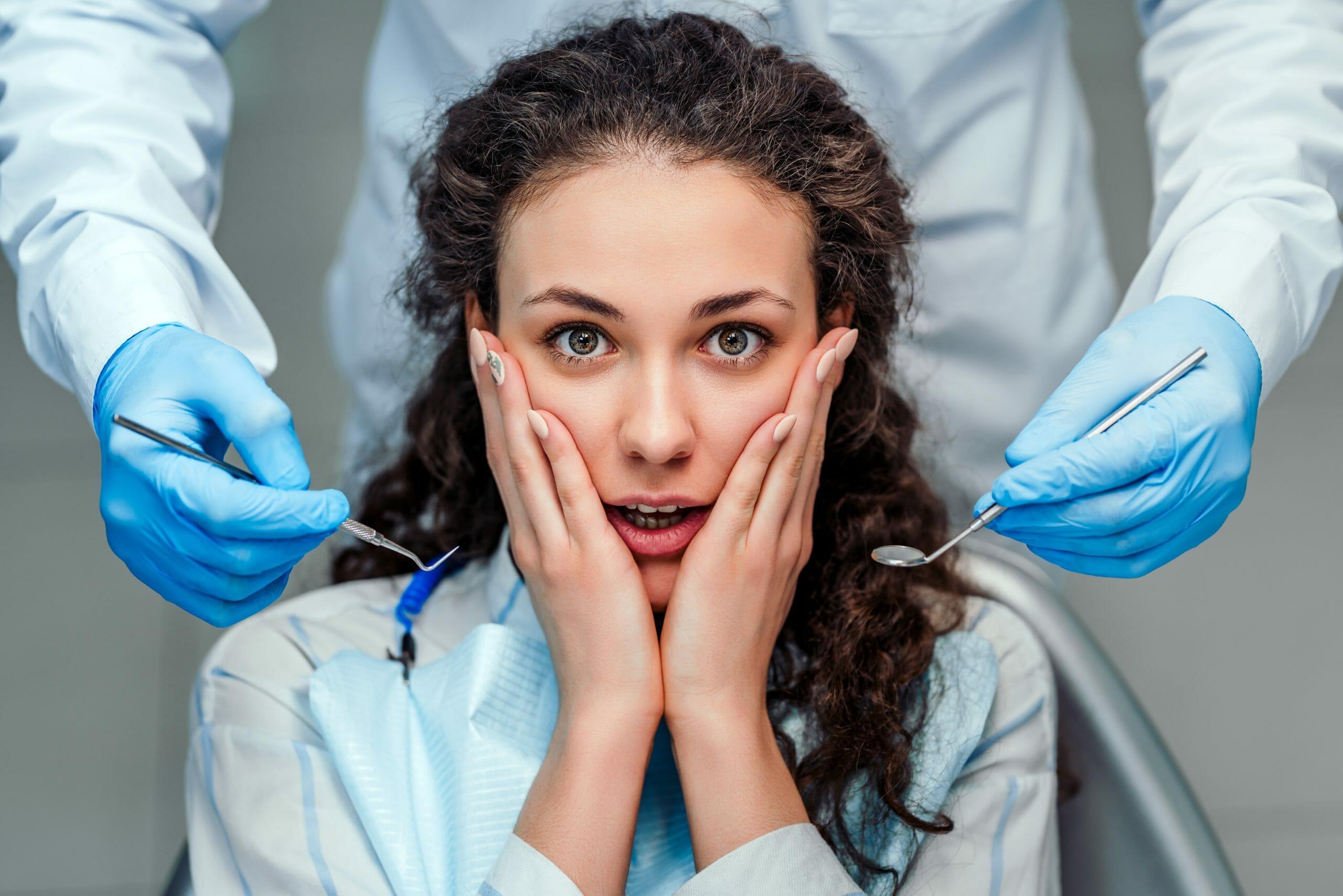 Dentist with Gum Stimulator and Mirror in hand