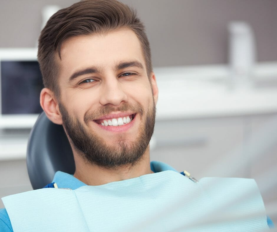 Young man smiling in dental chair